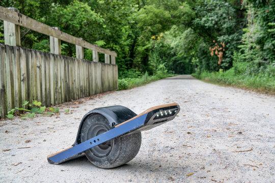 One-wheeled electric skateboard (personal transporter) on a gravel bike trail