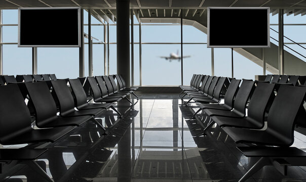 Rows Of Black Chairs At Airport And Plane Landing, There Is A Path For All Windows