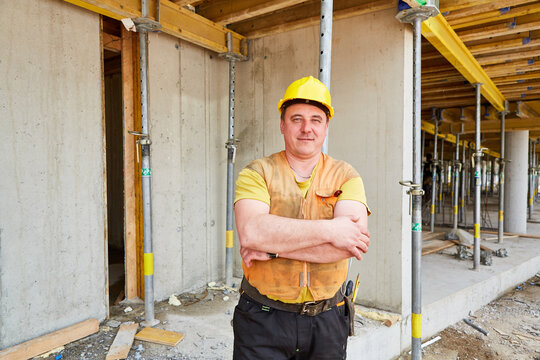 Man with a yellow hard hat as a construction worker