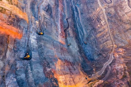 Aerial view of an open pit of iron ore. Resource mining