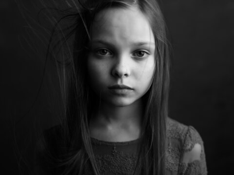 little girl posing long hair close-up black and white photo