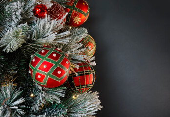 Christmas tree decorated with traditional Christmas decorations, illuminated by Christmas lights that flash with a play of shadows and lights wishing a Merry Christmas. Gray color background