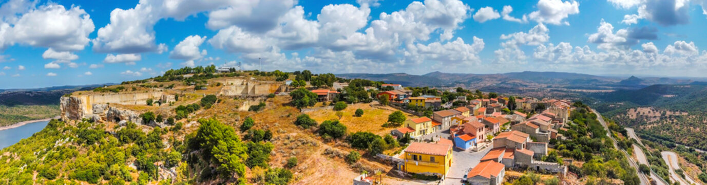 Panoramic view of Monteleone Roccadoria under a blue sky