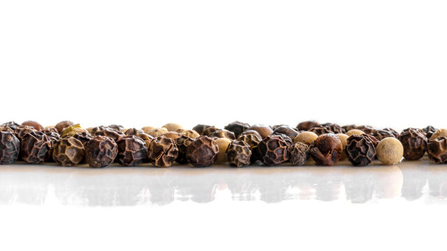 Peppercorns Macro Reflected over White