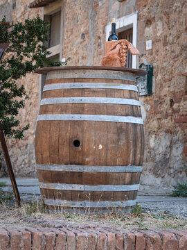 Wine Barrel with a Bottle of Wine on it Outdoor in a Public Street