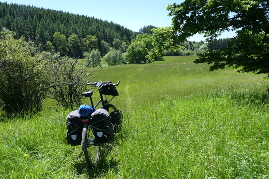 Adventure, a bike makes its way through the meadow.