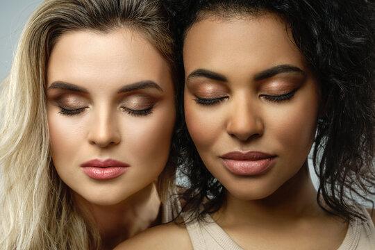 Portrait of Caucasian and African American women in studio