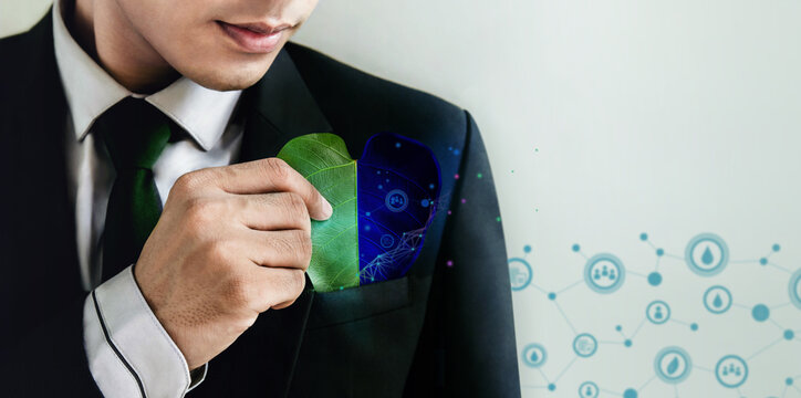 ESG Concept. Nature Meet Technology. Green Energy, Renewable and Sustainable Resources. Ecology Care,Environmental, Social and Corporate Governance. Businessman insert a Leaf in Pocket