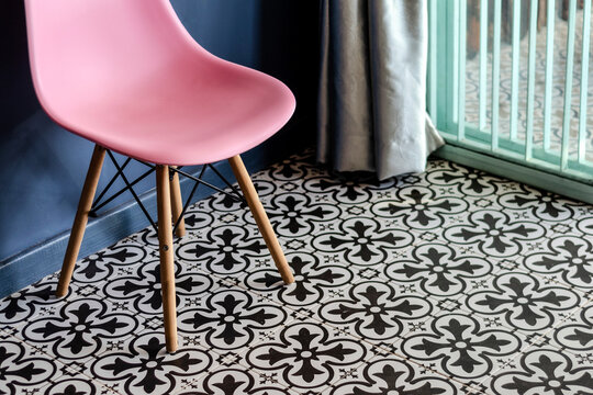 colorful retro furniture interior design detail with vintage tiles and chair