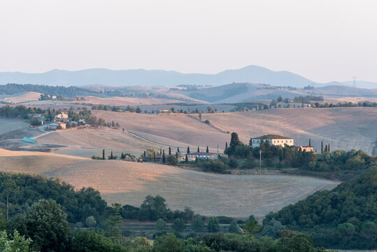 The landscapes of Tuscany with their typical architecture, agricultural use and widespread hills.