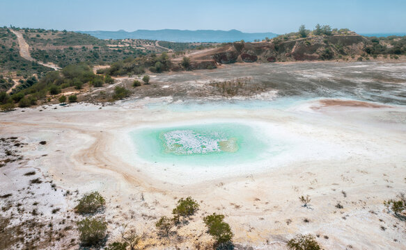 Open pit of old copper mine with dried polluted lake bed in Limni, Cyprus. Aerial landscape