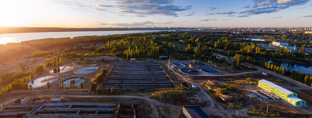 Modern wastewater treatment plant, aerial view from drone at the evening sunset