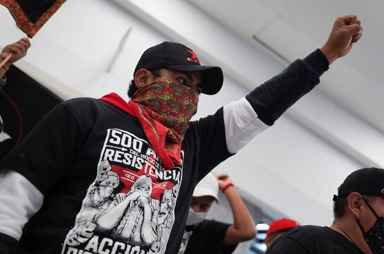 A member of the delegation of the Zapatista National Liberation Army (EZLN) welcomes fellow members, in Mexico City