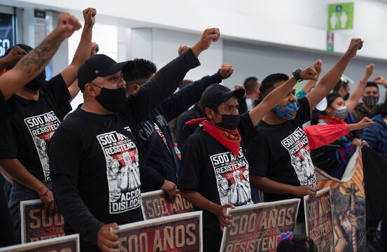 Members of the delegation of the Zapatista National Liberation Army (EZLN) welcome fellow members, in Mexico City