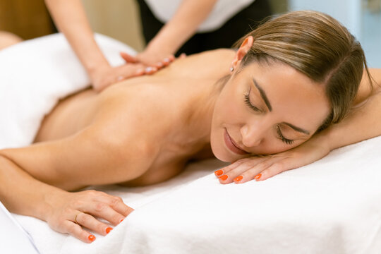 Middle-aged woman having a back massage in a beauty salon.