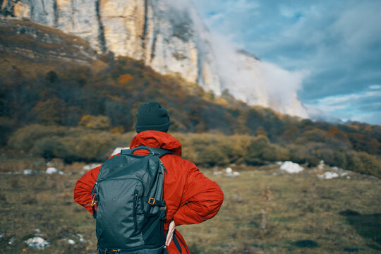 woman traveler with backpack mountains landscape freedom