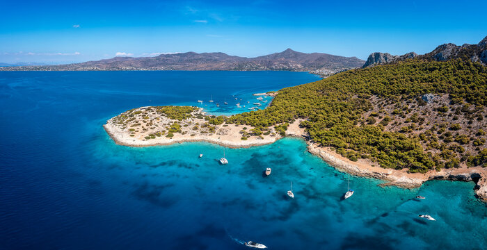 The beautiful coast of Moni island, next to Aigina in the Saronic Gulf of Athens with turqoise sea and lush, green hills