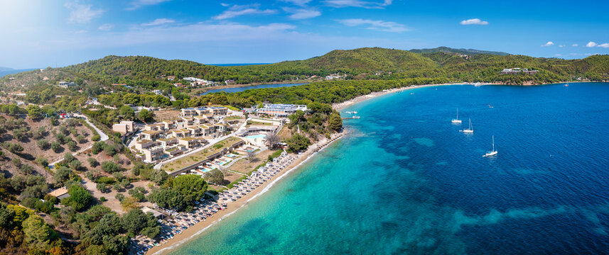 Panoramic aerial view to the bay of Koukounaries with Xenia Beach in the foreground, Skiathos island, Sporades, Greece