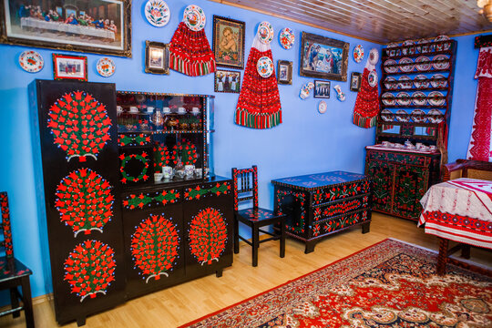 SIC, ROMANIA - JUNE, 2014: Hungarian room of a well preserved heritage. Everything is hand-painted. Every house has a room with the heritage, at June, 2014, in Sic (Szek), Romania