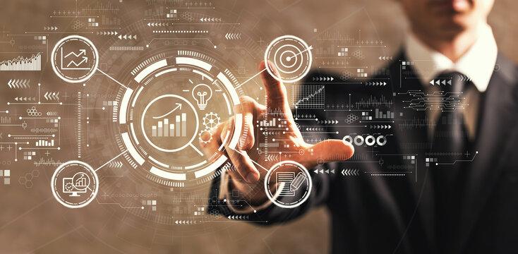 Data Analysis concept with businessman on dark vintage background