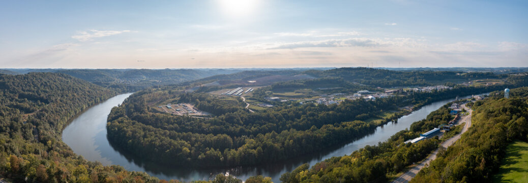 Panoramic aerial view of Morgantown in West Virginia from Dorseys Knob towards the industrial estate wtih the storage of gas pipeline pipes