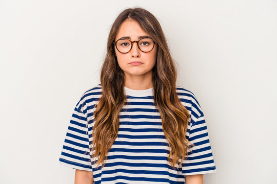Young caucasian woman isolated on white background sad, serious face, feeling miserable and displeased.