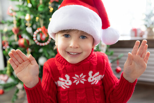 Funny kid greeting in video chat. Xmas holiday concept