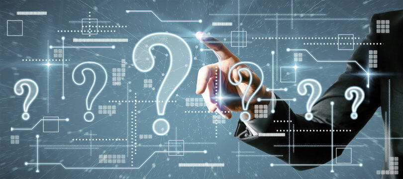 Businessman hand pointing at creative glowing question marks interface on blue background. Technology, business help and faq concept.