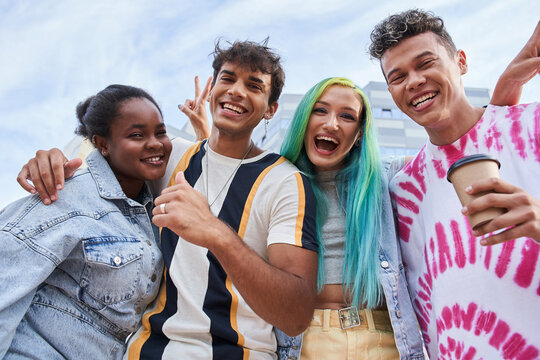 Trendy millennial people laughing out loud and posing to the camera