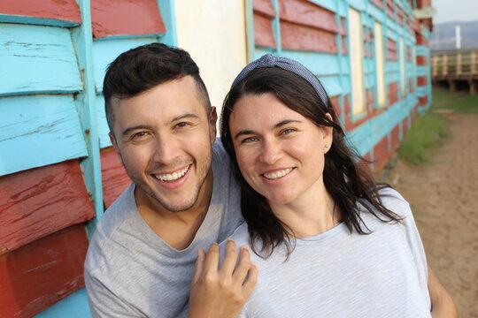 Beautiful interracial couple smiling outdoors