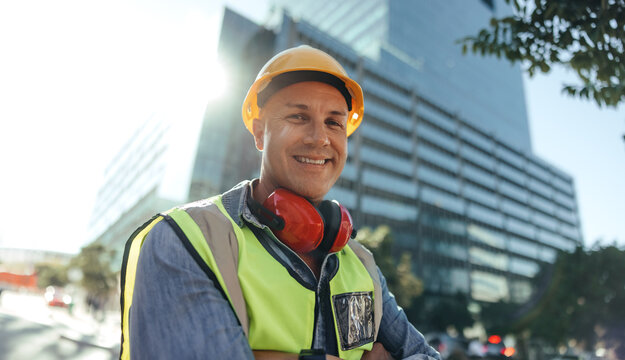 Cheerful workman smiling at the camera in the city