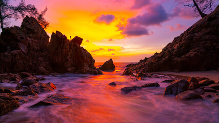 Long exposure image of Dramatic sky seascape with rock in sunset scenery background Amazing light nature landscape