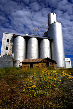 Old Abandoned Granary Grain Silo in Rural Area Blue Sky and Dramatic Clouds