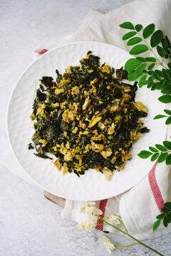 Moringa egg stir fry - healthy side dish with muringa leaves, selective focus