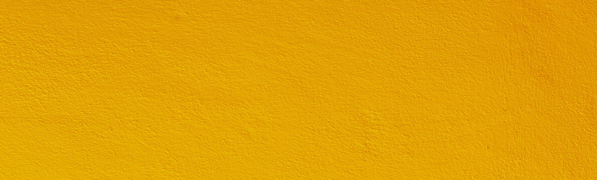 Yellow color old grunge wall concrete texture as background.