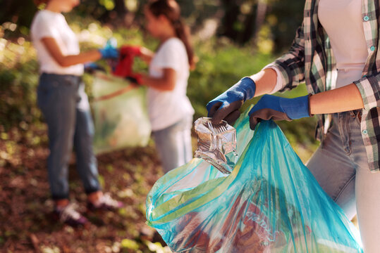 Volunteers cleaning up the city park