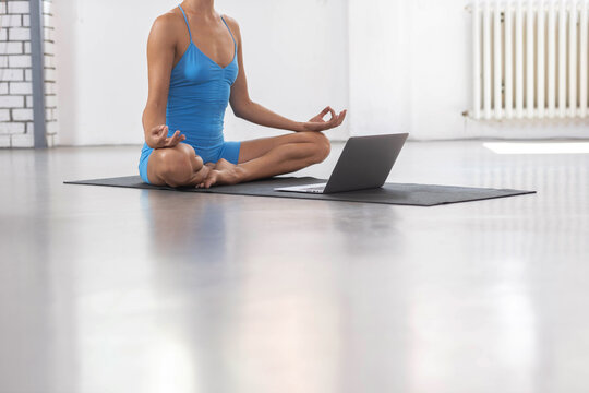Close up of a woman sitting in front of a laptop meditating, female torso, mental exercise