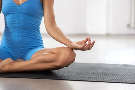 Close up of a woman meditating in sukhasana pose, or the so called easy pose, mindfulness concentration