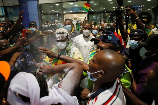 Supporters welcome Ghana's boxer, Takyi as he arrives at the Kotoka International Airport in Accra