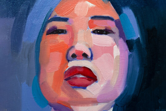 Young asian woman artistic portrait in oils and acrilic blue and violet colors