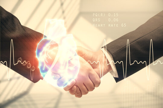 Double exposure of heart hologram and handshake of two men. Medical concept