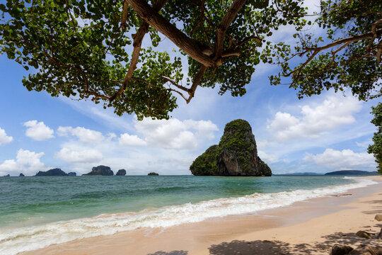 Paradise beach on tropical island with blue sky at Railay beach, Krabi