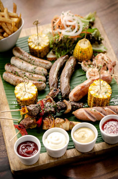 organic mixed grill barbecue meat platter rustic set meal