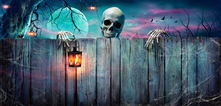 Halloween - Skeleton Holding Lantern On Wooden Banner In Night