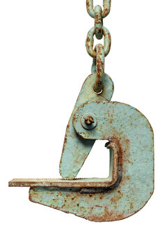 Old rusty construction crane hook and chain