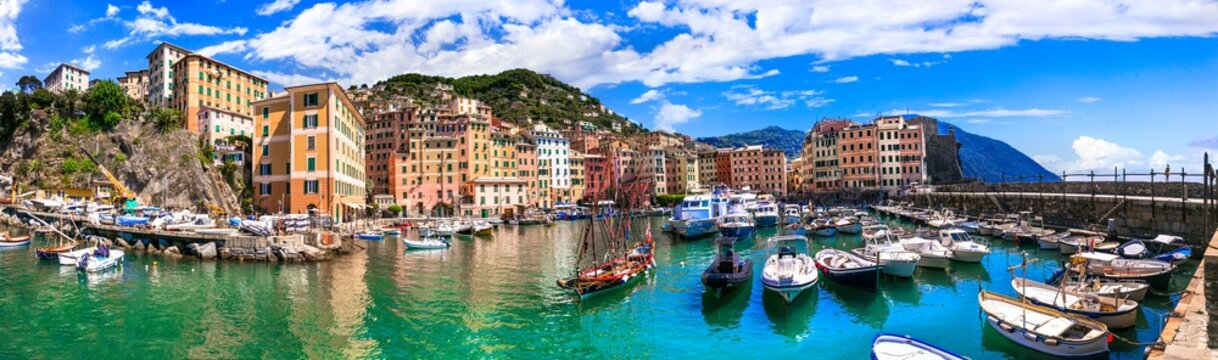 Camogli - beautiful colorful town in Liguria, panorama with traditional fishing boats .popular tourist destination in Italy