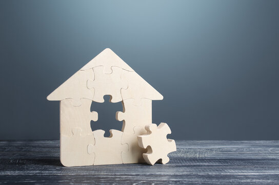 Puzzle house with a missing part. Housing construction, design and engineering. Mortgage loan for purchase real estate. During construction work. Reconstruction, renovation. Investments in building