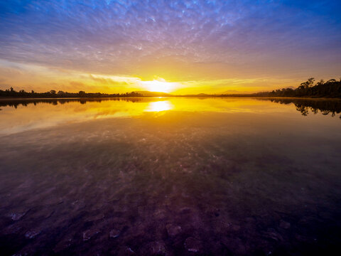 Sky light reflection at dawn reservoir.