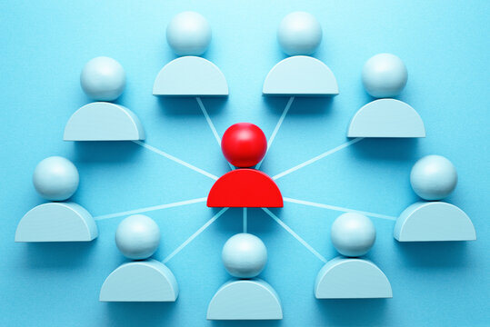 Team network and communication. Hand pointing red person icon block.