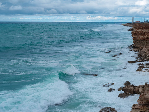 Beautiful view of ocean waves and a fantastic rocky shore, Sea patterns, background wallpaper.